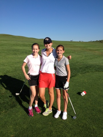 Emma Schiller, Sarah Morrill, Mackenzie Fleming pause in the middle of the action at Sassamon Trace for a photo op.