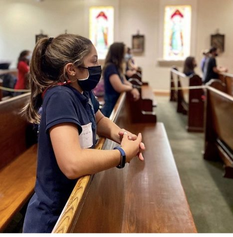 A Montrose seventh grader prays in the chapel during daily Mass.