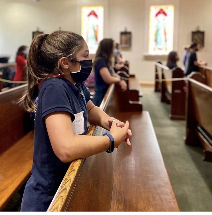 A+Montrose+seventh+grader+prays+in+the+chapel+during+daily+Mass.