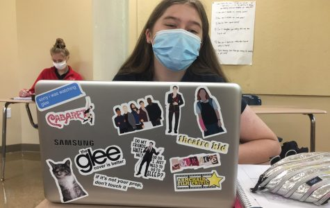 Glee superfan Lucy Stefani '21 with her Glee and theatre-inspired laptop stickers.