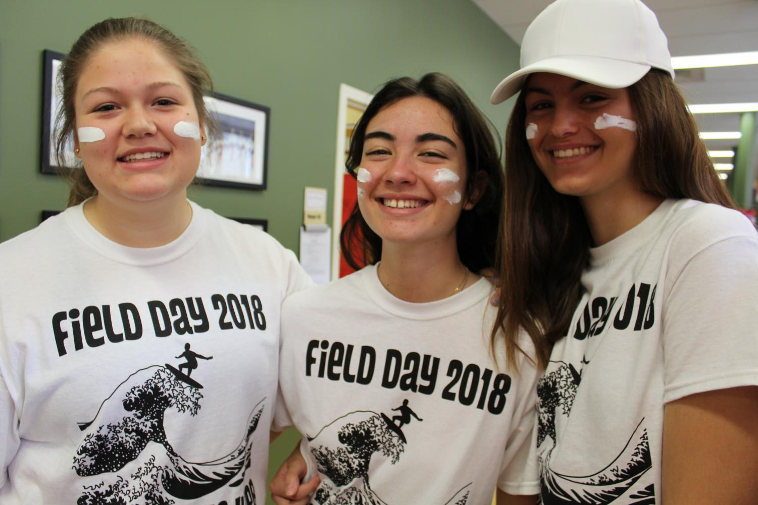 Ally '21 smiles with exchange students Lucia '21 and Elena '21 on field day.