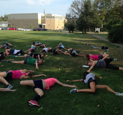 Cross-Country team warms up with some yoga before the big meet!
