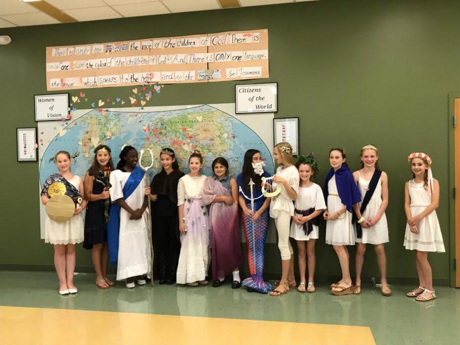 Sixth graders wearing creative costumes emulating Greek gods and goddesses.