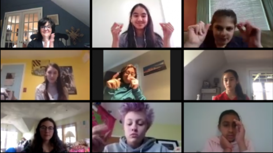 Students+and+teachers+snap+their+applause+for+the+poetry+performers+at+the+Virtual+Poetry+Jam%21