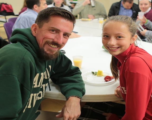 Mary Dyke '20 enjoys breakfast with her dad, Mr. Dyke, at the Father-Daughter Bagel Breakfast.