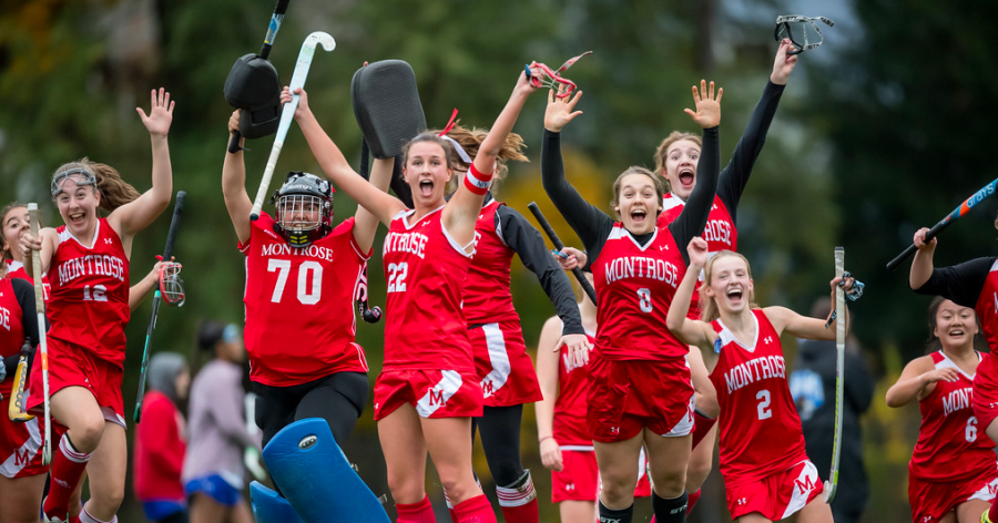 Field Hockey Co-Captain and Co-Sports Editor Mary McManmon '20 jumps for joy with her teammates after a game at McCarthy Field last fall.