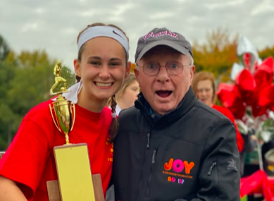 Devyn Gianino 20 stands with her grandpa on Miracle Field last fall after captaining the Montrose Varsity Soccer team to another victory in the IGC Championship!