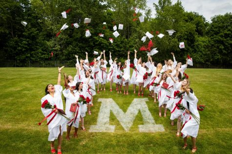 The Class of 2021 graduated last week on Miracle Field, throwing their caps in celebration.