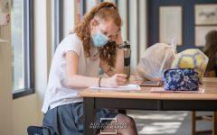 Junior Olivia Mahoney 23 works at an upper school table after school.