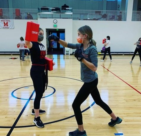 Faye Stearns '24 and Meredith Ehrenzeller '24 practicing their strikes after school.